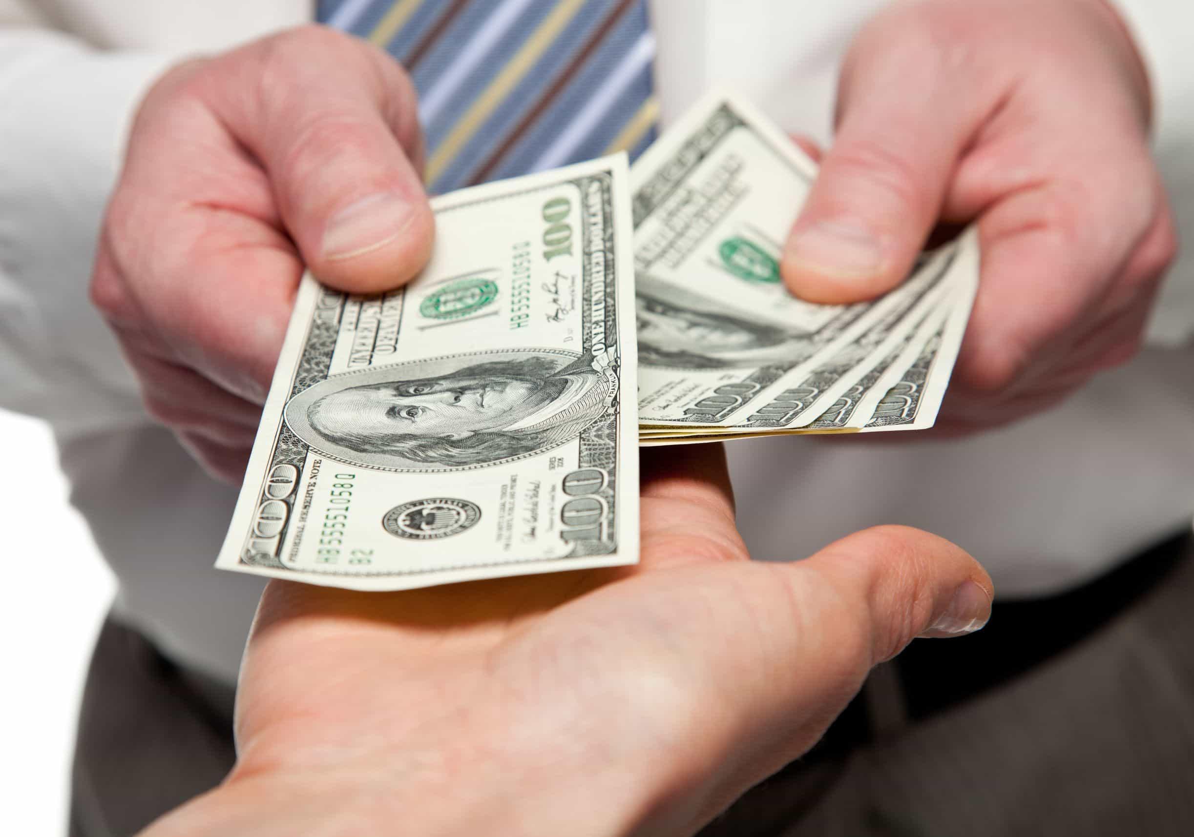 image of hands paling money