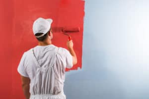 Man painting with roller
